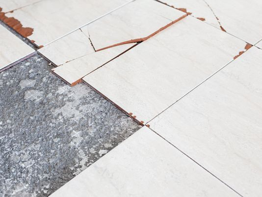 Tiles Or Glue May Contain Asbestos Homeowner Says - Removal of asbestos tiles from concrete floor